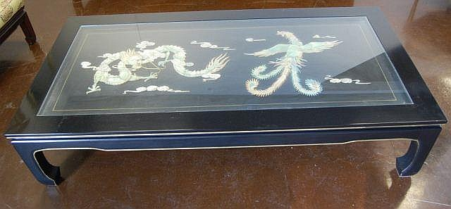 Glass top and carved mother of pearl coffee table