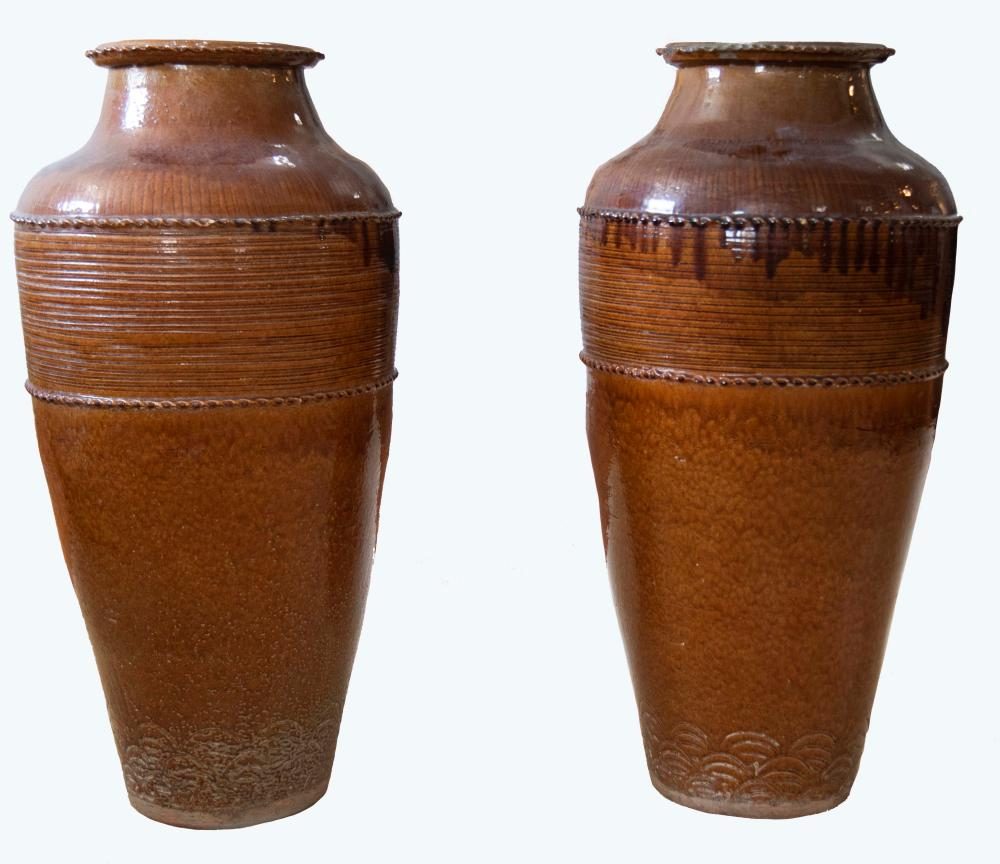Pair of glazed pottery vessels height: 38''