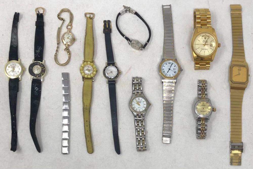 Eleven vintage wristwatches includes: Sheffield, reproduction man's Rolex and female Rolex, Benrus, Seiko, Wittnauer, Carter, Hanover and Renoir.