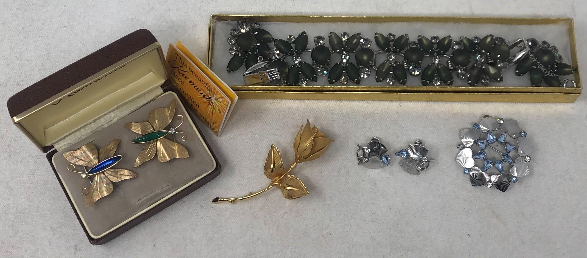 Krementz, CA, Giovani and other Costume Jewelry comprising: two Krementz, Newark, NJ butterfly pins, one with blue stone and one with green stone in original box with warranty papers; CA Sterling and blue rhinestone c...