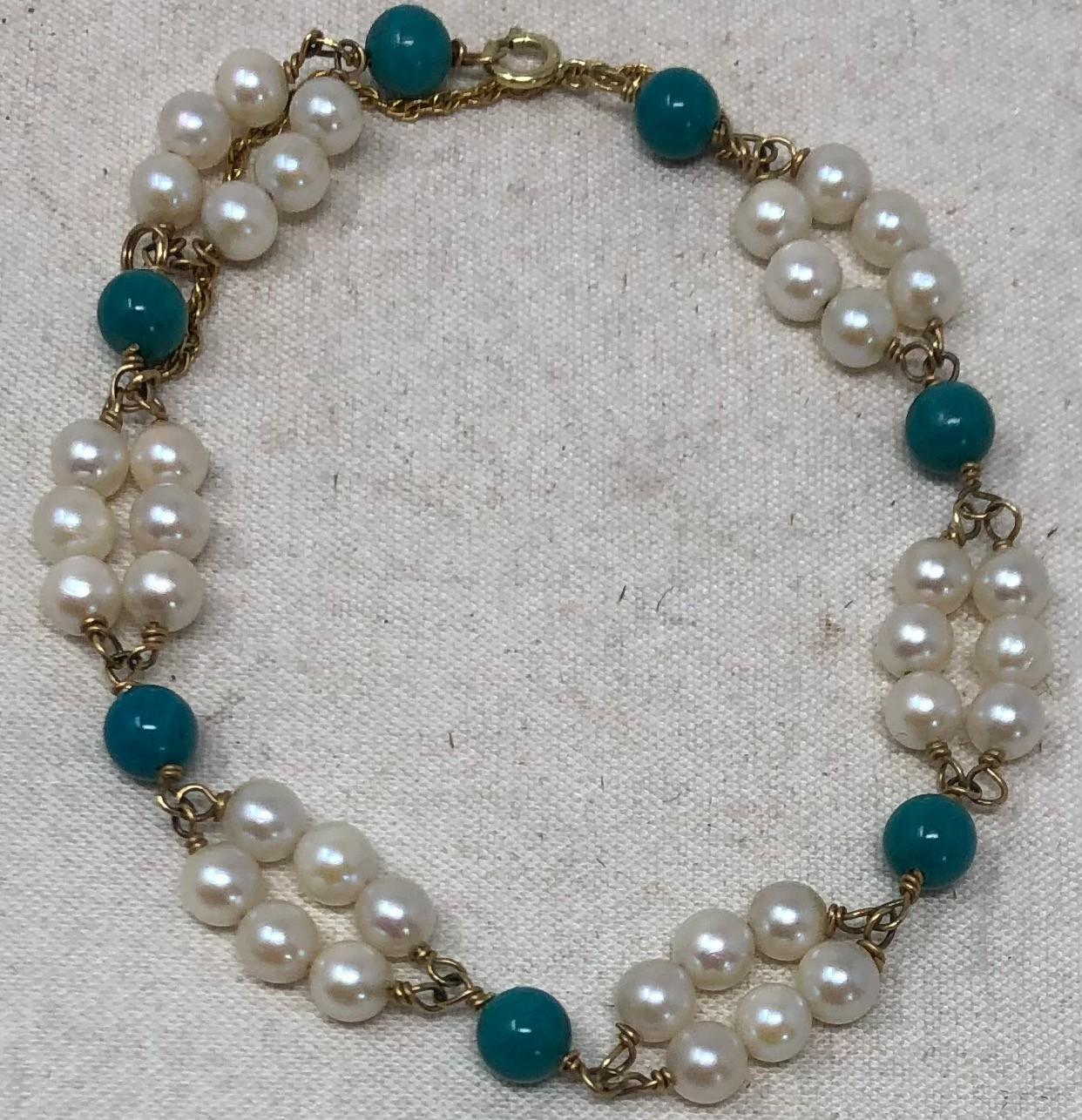 Pearl, turquoise and 14k gold bracelet with six separate sections comprising double rows of three pearls attached with 14k wire wraps, alternating with turquoise bead and 14k gold clasp.