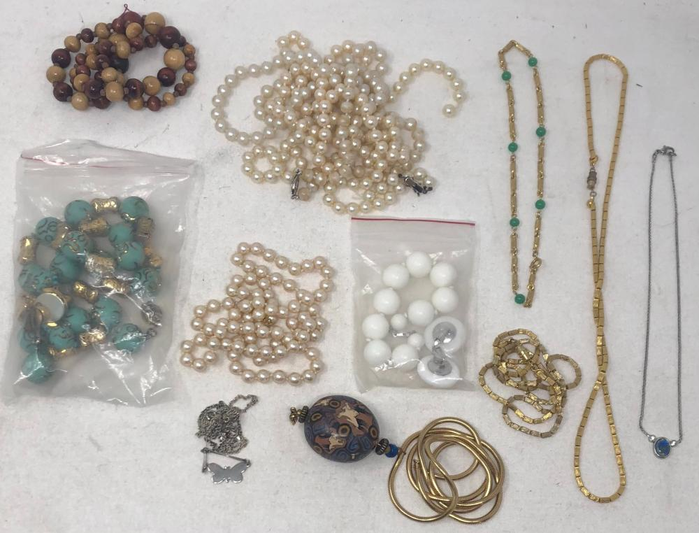 Group of costume jewelry comprising: aqua color bead necklace, length 22 inches, with matching ball earrings; brown bead necklace in graduated size, length 22 inches; two gold tone chain necklaces with cylindrical lin...