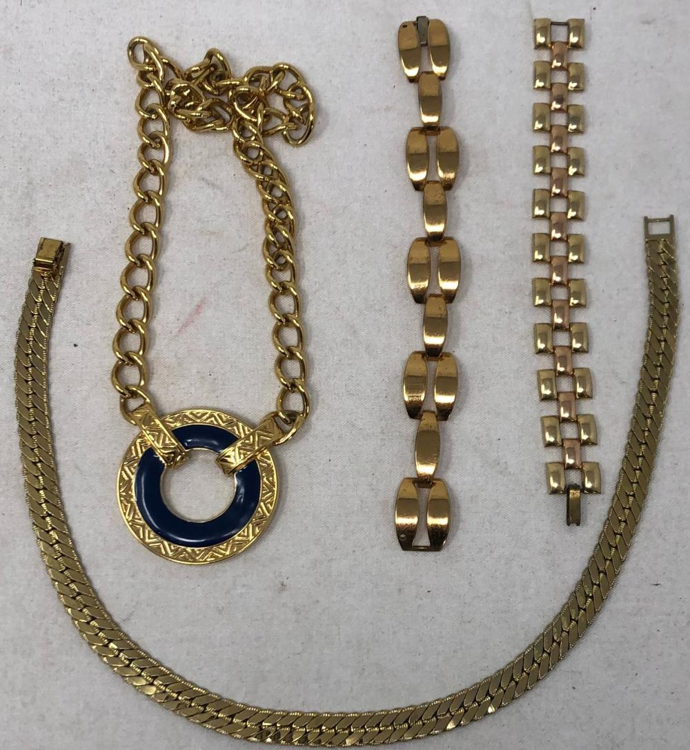 Costume jewelry consisting of: Vintage Monet statement chunky blue enamel and gold tone medallion necklace, 18 inches; Coro gold tone link bracelet; Monet flat snake link gold tone choker necklace, gold tone retro lin...