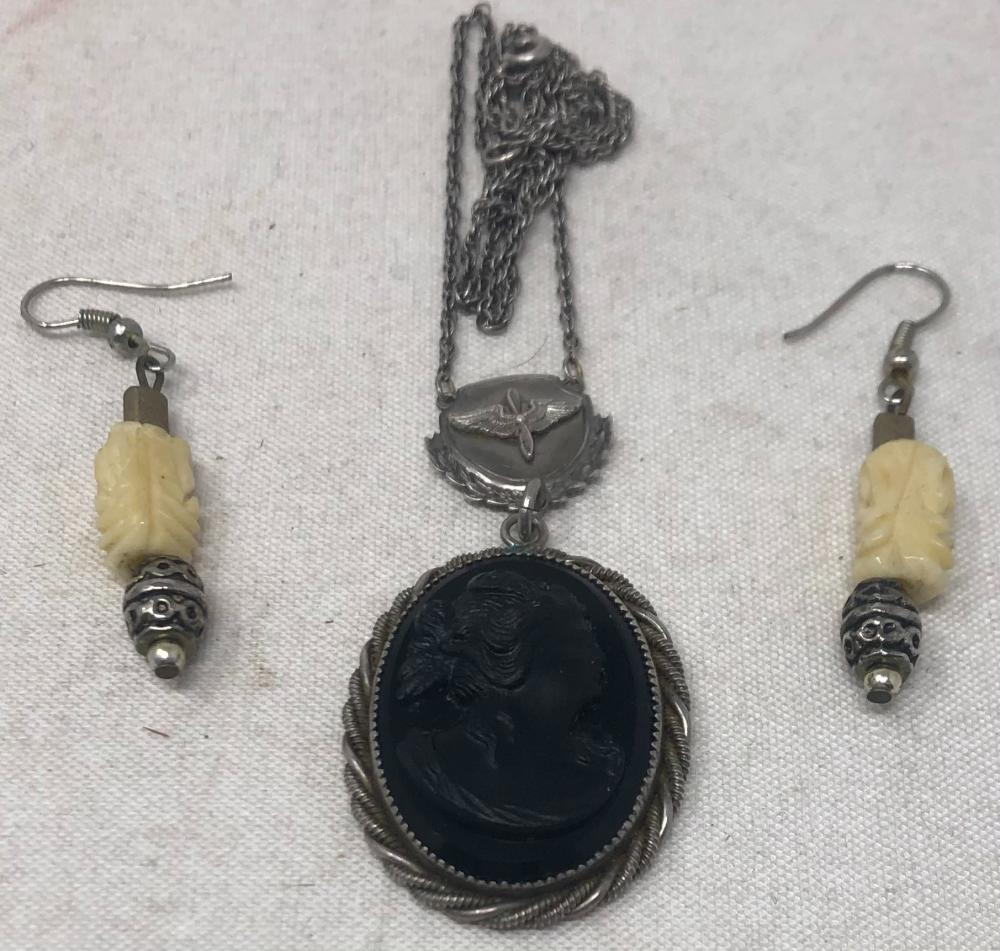 Vintage Durocharm sterling chain with jet black glass cameo pendant necklace, chain length 18 inches, cameo 1 1/4 x 1 inch; together with pair of white carved stone earrings.
