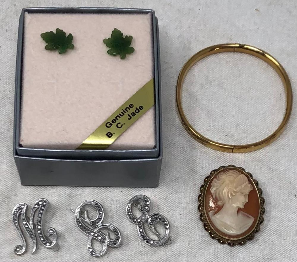 """Jewelry comprising: three silver and marcasite initial pins, with the letters: """"M"""", """"E"""", and """"L""""; 14k gold filled child's bracelet; 14k and gold British Columbia jade leaf earring studs in original box, Made in Canada..."""