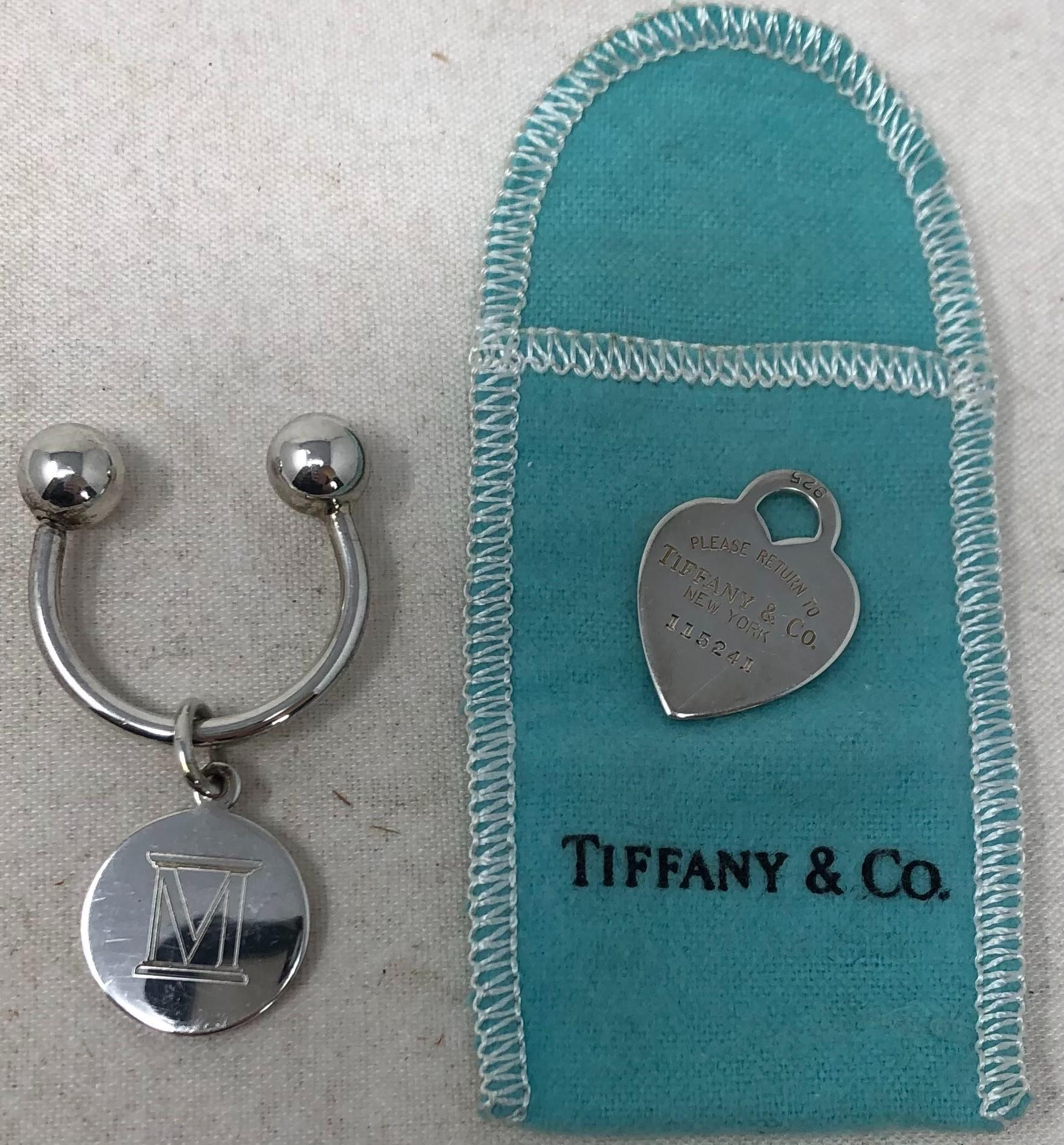 Tiffany sterling silver heart charm and key ring with Metropolitan Museum commemorative 90 year anniversary charm.