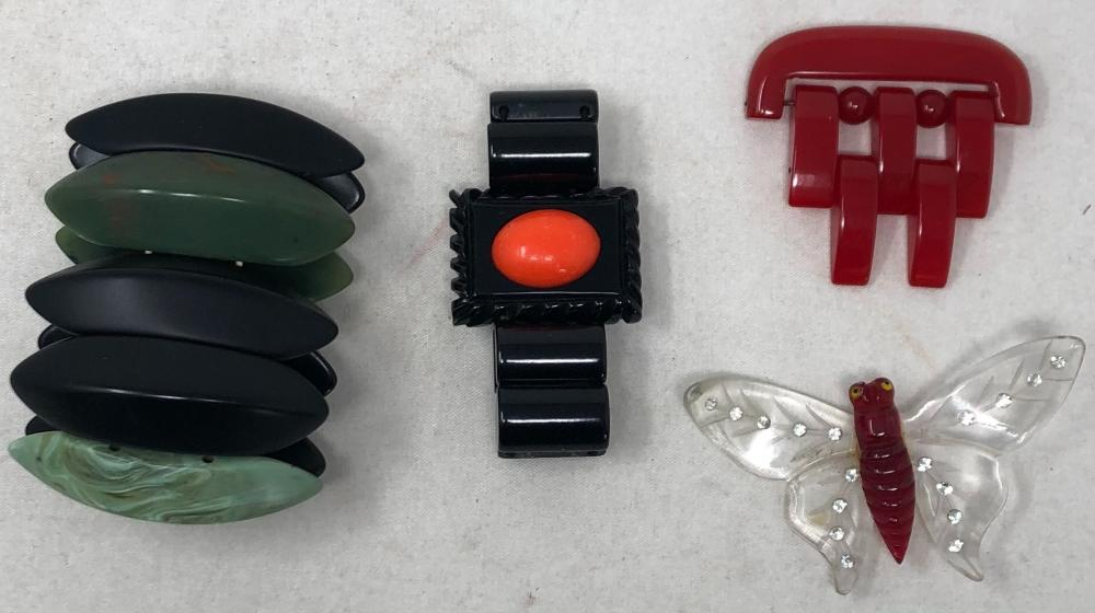 "Vintage Bakelite and plastic jewelry: Black Bakelite bracelet with oval faux ""coral"" stone set in square panel with rectangular solid link flexible bracelet; bracelet consisting of large marquise shaped solid black li..."