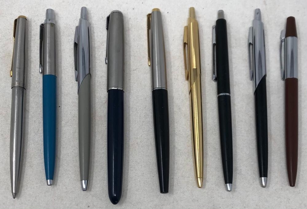 Nine Parker and Papermate Pens consisting of 5 Papermate ball point pens, 2 Parker ball point pens, 1 Parker fountain pen and 1 marker.