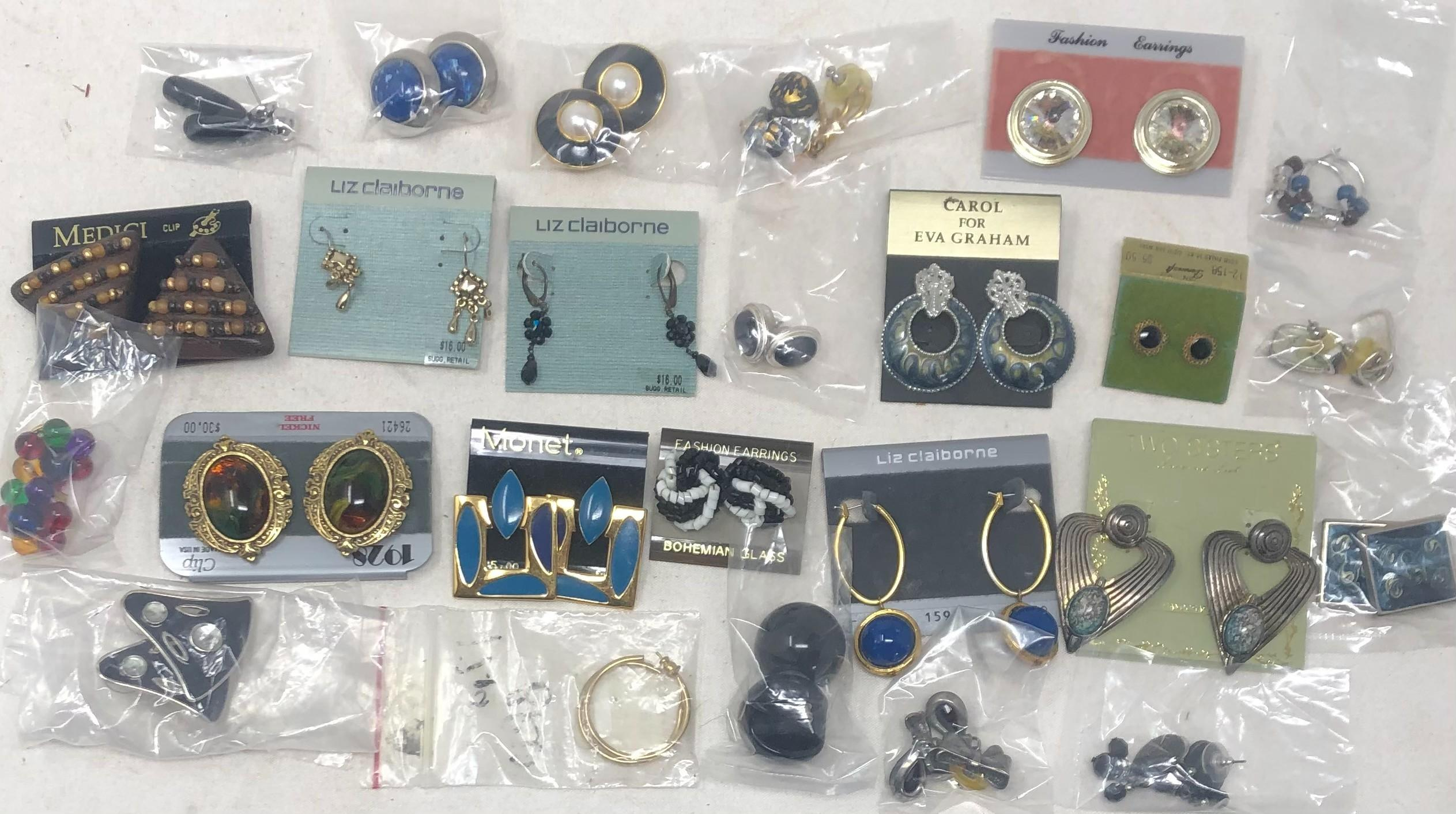 Twenty-five pairs of costume earrings includes Monet, Liz Claiborne, Two Sisters, Medici and 1928 in various styles.