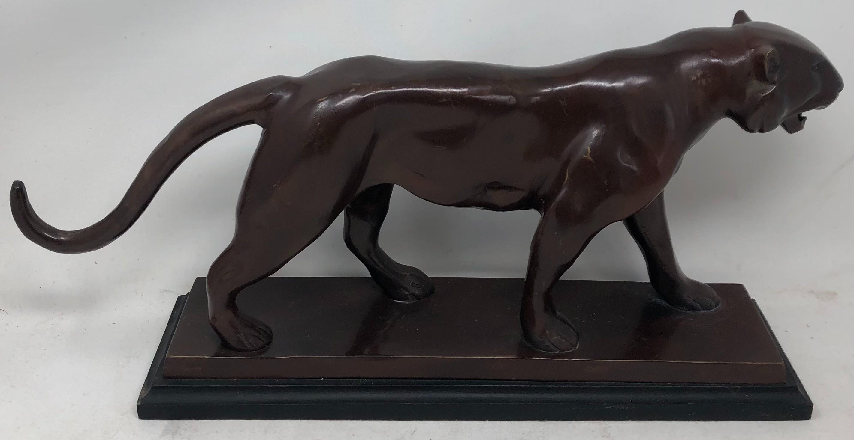 Bronze statue of a lion. (length: 19 inches)