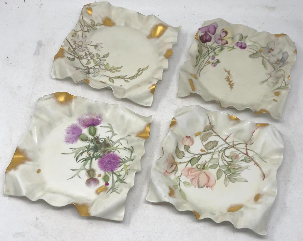 Four hand painted plates with ruffled edges.