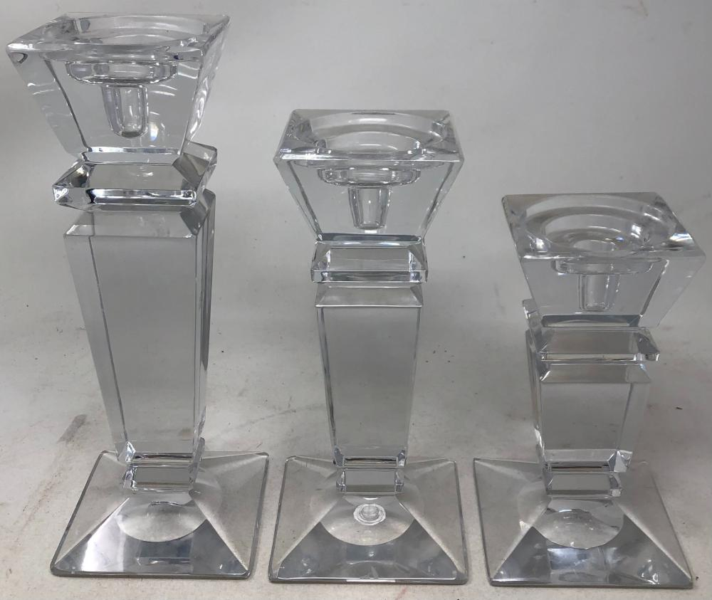 Set of three crystal candlesticks in graduating sizes.