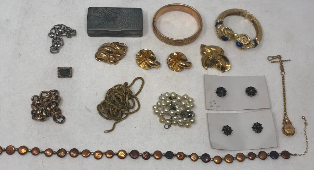 Collection of Vintage costume jewelry comprising two necklaces, one long gold toned rope, 60 inches, one brown pearlescent beads, length 15 inches; one faux pearl necklace, length 16 inches; four bracelets, one animal...
