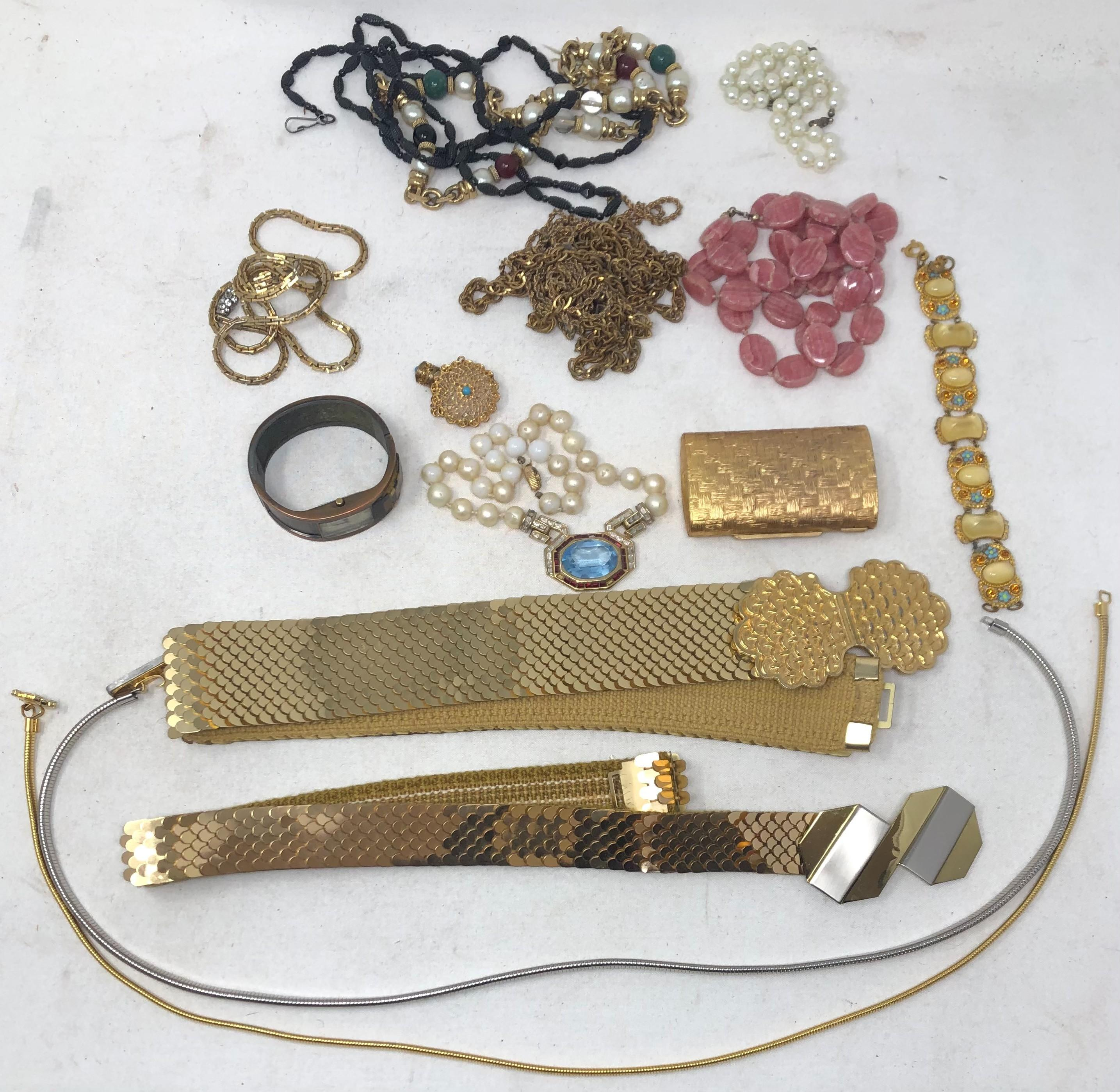 Collection of costume jewelry and lady's belts: four belts include two gold tone stretch with contemporary design buckle, width 1 3/4 inches on one; two thin stretch with one rhinestone buckle; one wheat pattern compa...