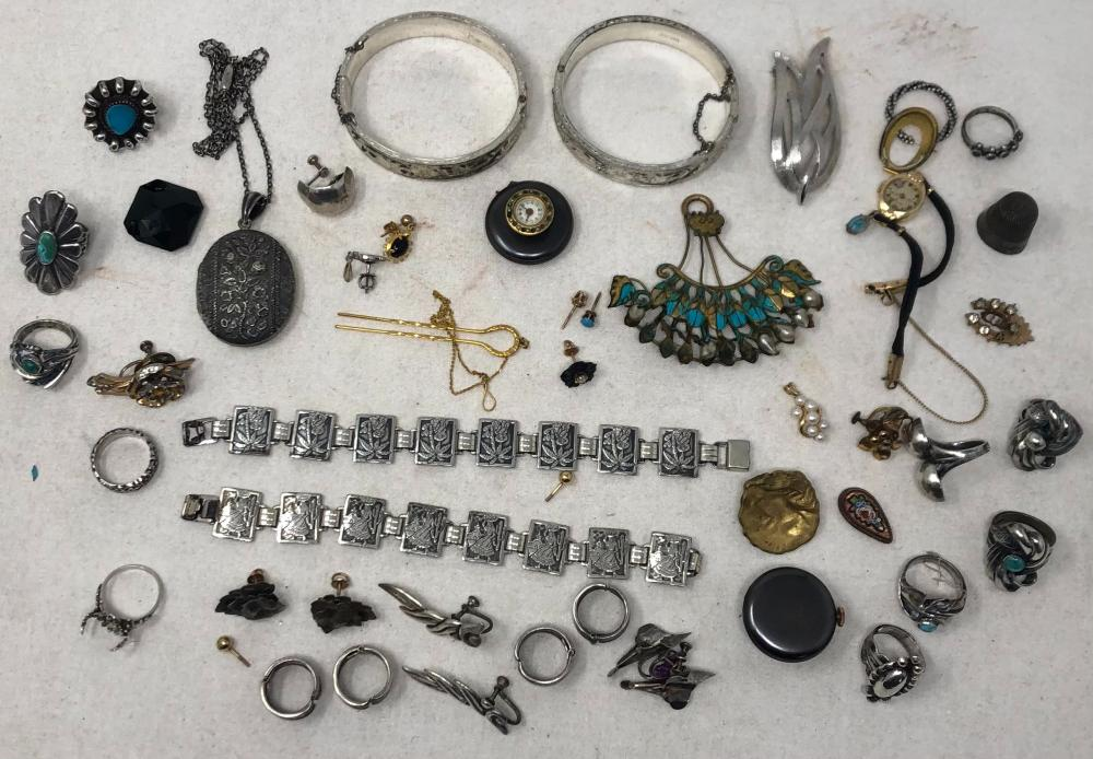 Large group of Vintage costume and sterling jewelry: two sterling Dunn Bros. engraved bangle bracelets and two sterling large links engraved with spanish woman and one with palm trees; one 14k and small pearl pendant;...