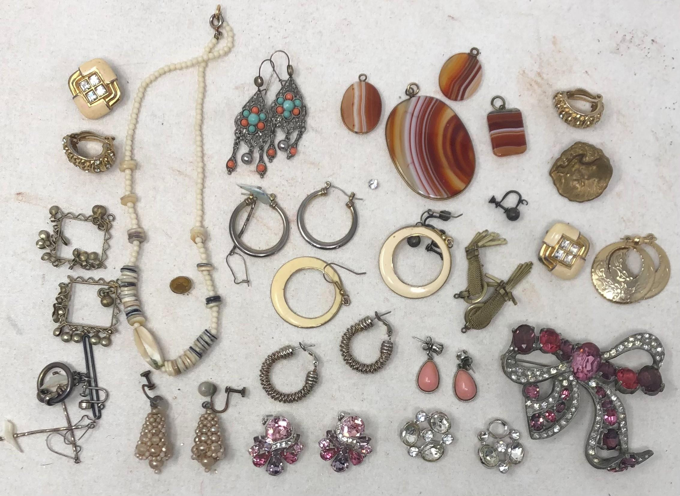 Group of costume jewelry include white bead necklace, length 14 inches; large floral form rhinestone brooch, illegibly marked Fisenheuer, fifteen pairs of earrings, some with rhinestones, colored beads, brass; four br...