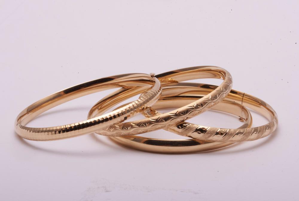 Set of Four Gold Bangle Bracelets