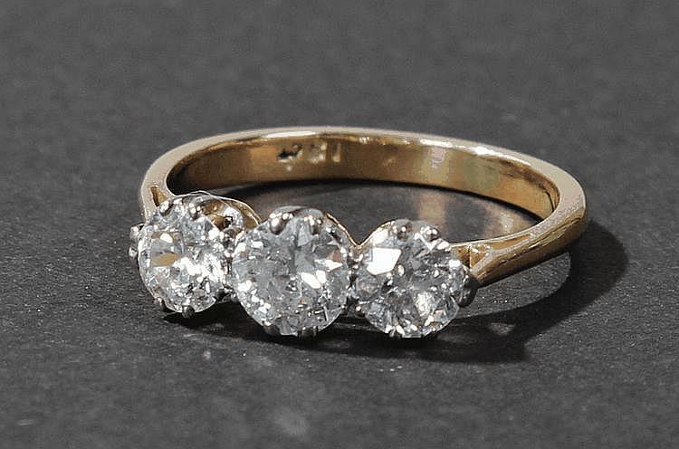 18 carat gold three stone diamond ring, the