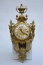 A  Louis XVI style cartel clock in bronze * (40x88cm)