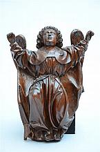 An angel in sculpted walnut (39cm)