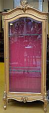 A gilt Louis XV style vitrine (75x180cm)