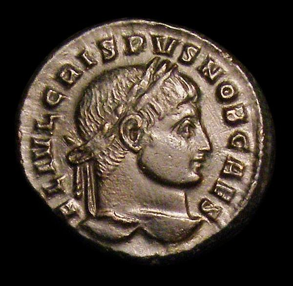 Crispus as Caesar. Ae3. Sirmium mint. C, 316-326 AD. Rev; ALAMANNIA DEVICTA; Victory advancing right, holding trophy and palm frond; captive to right, • SIRM • in ex. RIC 49. Scarce. 3.15g. VF