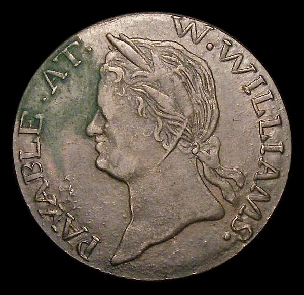 Halfpenny Evasion 1792 Obverse bust left: PAYABLE AT W.WILLIAMS Reverse Crowned Harp NORTH WALES date 1792 in mirror image Coleman EH-421 VF or better with much sharp detail, with a stain on the obverse nevertheless very rare in this higher grade
