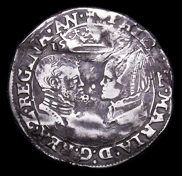 Sixpence Philip and Mary 1557 S.2506 mintmark Lis portraits around Fine and well defined, creased