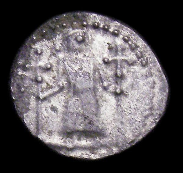 Anglo-Saxon Early Period Silver Sceat Series L (London) type 23e Obverse Standing figure holding two crosses, Reverse a whorl of three wolf heads S.804H Fine