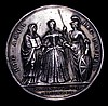 Coronation of Caroline 1727 34mm diameter in Silver by J.Croker, Eimer 512 the official Coronation issue Obv. Bust Left CAROLINA. D.G.MAG.BR.FR.ET.HIB.REGINA. Rev The Queen standing flanked by Religion and Britannia. HIC.AMOR.HAEC.PATRIA Exergue