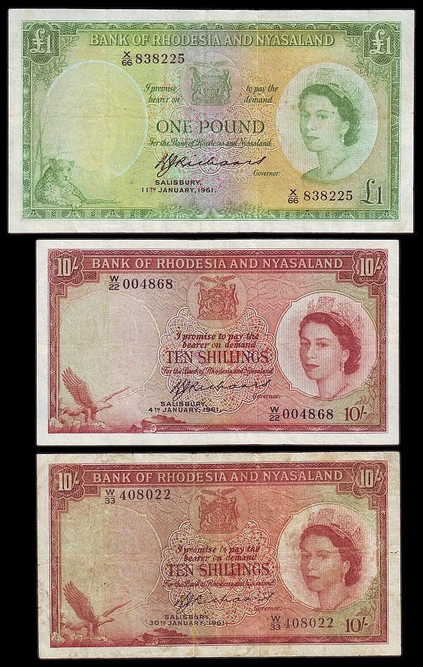Rhodesia and Nyasaland (3) 10 Shillings 1961 Pick 20b Signature Richards W/22 004868 Fine or better, pressed, 10 Shillings 1961 issue Richards signature W/33 408022, Pick 20b VG with a small pinhole at left, and tape residue mark on the reverse,