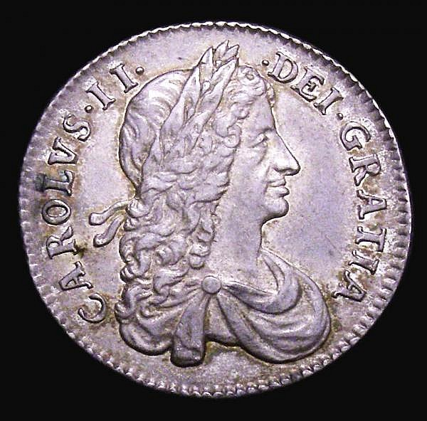 Shilling 1663 First Bust variety ESC 1025 GVF/NEF with traces of underlying lustre and with an attractive light golden tone