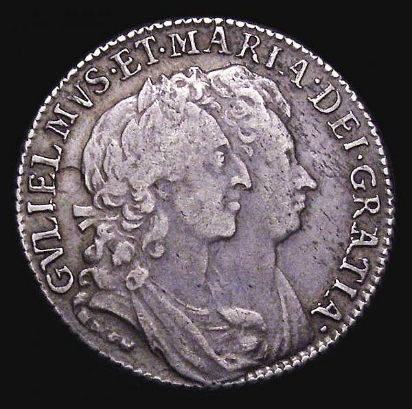 Shilling 1692 AT over TI in GRATIA Bull 866, unlisted by the 1992 ESC, Fine/Good Fine the obverse with a curved flan flaw behind the bust, Ex-M.Rasmussen