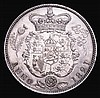 Halfcrown 1821 ESC 628 UNC the obverse with small contact marks on the King's chin and a small rim nick by ANNO a sharply struck example with very few imperfections even under magnification, the reverse showing the intricate detail in full, even the