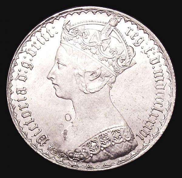 Florin 1886 ESC 863 EF or slightly better and lustrous, with an o-shaped area of tone in the obverse field