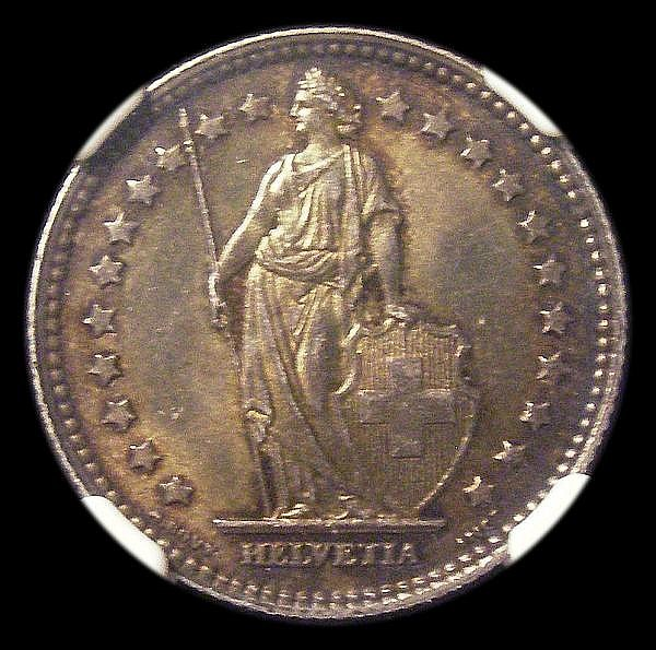 Switzerland Franc 1905 deeply toned Unc and graded MS62 by NGC KM24