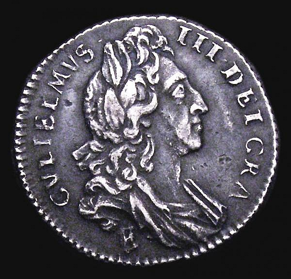 Sixpence 1697 First Bust, Small Crowns, E over B below bust ESC 1560A Near VF with deep grey tone, Extremely Rare, rated R4 by ESC, our archive database shows that this is only the second example, and easily the finest example we have offered since
