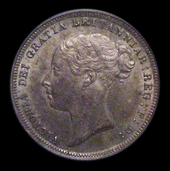 Sixpence 1887 Young Head ESC 1750 UNC and with an attractive tone, slabbed and graded LCGS 82
