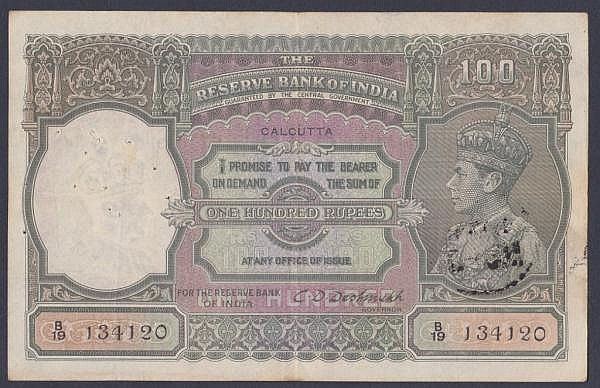 India 100 rupees KGVI issued 1943 series B/19 134120, Calcutta branch, signed Deshmukh, Pick20e, multiple pinholes at left & bank stamp reverse, Fine+