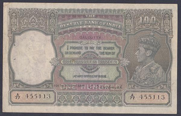 India 100 rupees KGVI issued 1943 series A/77 455113, Calcutta branch, signed Deshmukh, Pick20e, 2 staple holes at left, good Fine