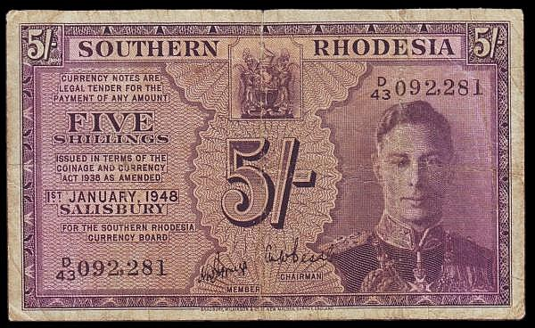 Southern Rhodesia Five Shillings 1948 issue Pick 8b VG some folds, with a small nick on the top edge and a pinhole at the centre