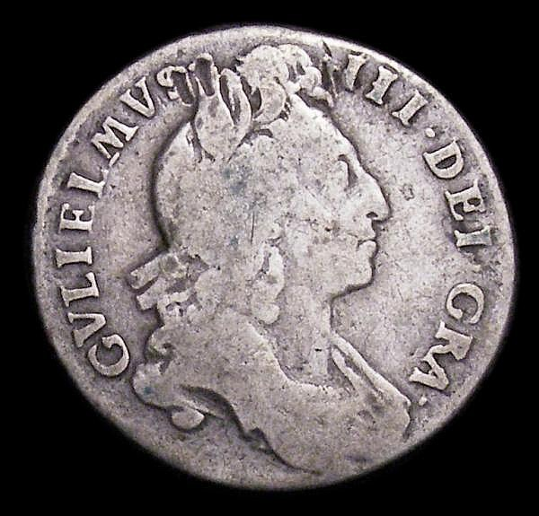 Sixpence 1697 First Bust, Small Crowns, Later Harp, Inverted A for second V in GVLIELMVS, also with G over O in MAG, this overstrike unrecorded, as ESC 1553, VG with both errors very clear, an unusual piece