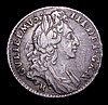 Sixpence 1696 B First Bust, Large  Crowns, B mintmark overstruck, broken at the top and base, the underlying letter unclear, Good Fine