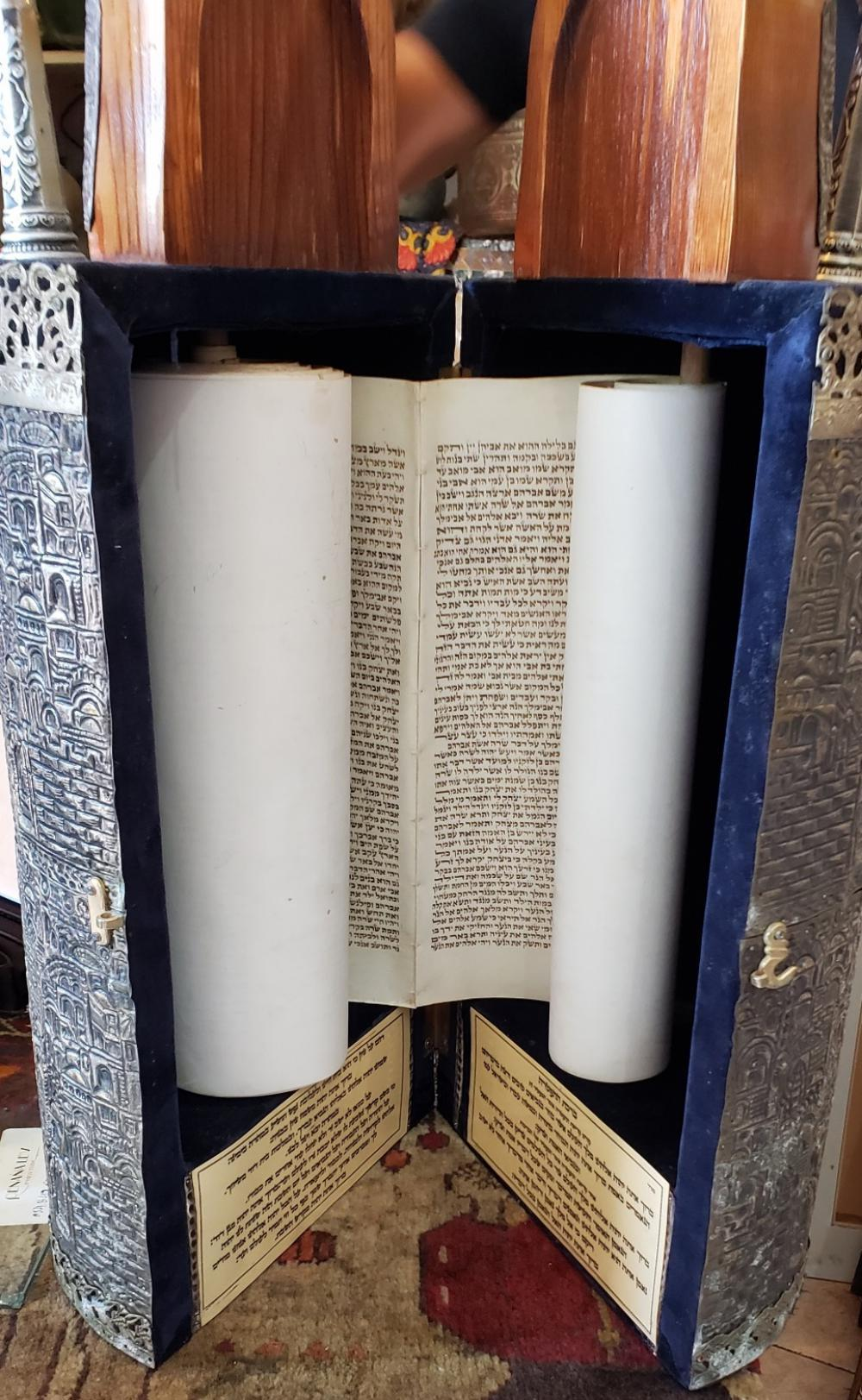 Lot 48: Judaica, Sefer Torah written by hand on parchment, includes a case Jerusalem 1950's