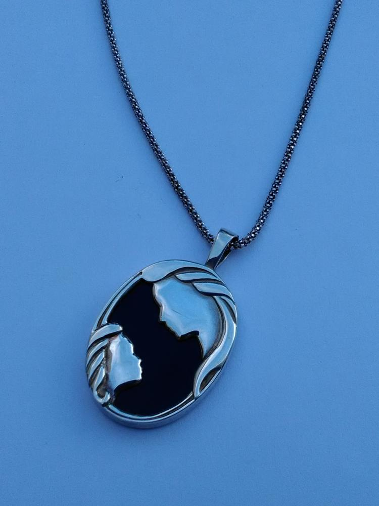 sterling silver and child pendant
