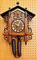 An Edwardian inlaid Black Forest cuckoo clock with
