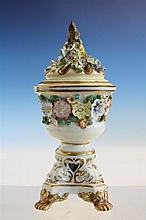 An English porcelain pastille burner early 19th century, probably Derby, of urn form with a band of applied flowers,