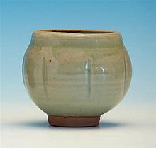 Bernard Leach (British, 1887-1979) a celadon glazed lobed ovoid vase, on a short unglazed foot,
