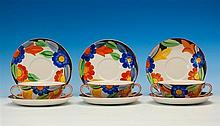 A set of six Susie Cooper for Grays Pottery soup bowls and saucers c.1930, in a bold hand painted Floral pattern,