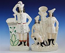 A flat back Staffordshire figure late 19th century, with Robin Hood standing next to one of his 'merry men',